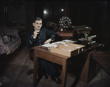 Air Commodore Sir Frank Whittle, 'father of the jet engine', at his desk.