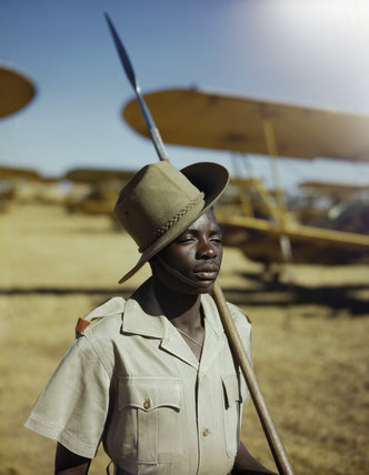 An African soldier or 'Askari' on guard duty at No. 23 Air School at Waterkloof, Pretoria, South Africa, January 1943.