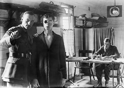 A new recruit to the British Army undergoing an eyesight test as part of his medical examination to asses his fitness for military service during the First World War.