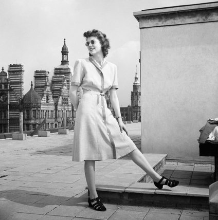A model poses on a Bloomsbury rooftop to show off her two-tone Atrima dress, costing 7 coupons.