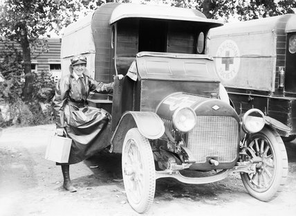 A member of the Voluntary Aid Detachment (VAD) with her motor ambulance, a vehicle of the Canadian Red Cross, at Etaples, France, on 27 June 1917.