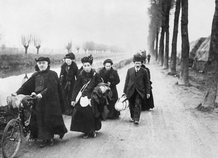 Group of elderly refugees trudging along the road from Merville,1918.