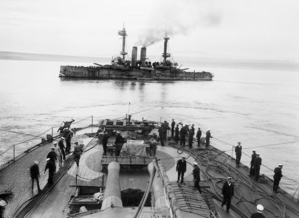 HMS Albion being towed by HMS Canopus after running aground off Gaba Tepe in the Dardanelles, 23 May 1915.