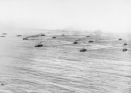 A Royal Navy convoy zig-zags through a danger zone in the Atlantic Ocean during the First World War.