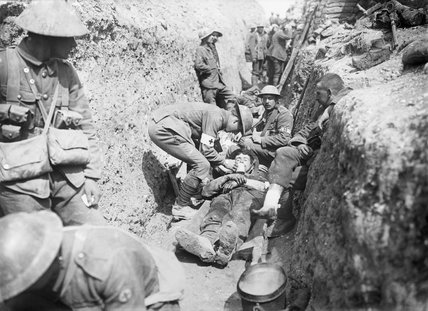 Wounded men being tended in a trench near Beaumont Hamel on the morning of the initial assault, Battle of the Somme, 1st July 1916.