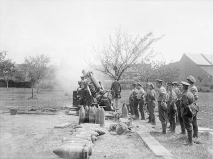 9.2 inch howitzer of the Royal Garrison Artillery in action in an orchard near Albert, Somme, July 1916.