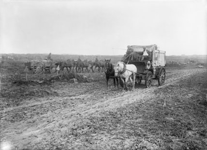 Field Ambulance waggon passing over muddy ground near Ovillers, Somme, September 1916.