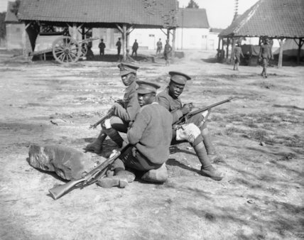 Troops of the West Indies Regiment cleaning their rifles on the Albert - Amiens road, September 1916.