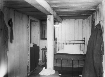 Interior of a German underground dugout complete with a brass bed at Fricourt.