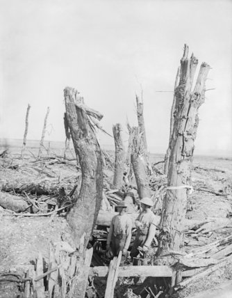 Two British soldiers standing in a wrecked German trench at Ginchy, Somme, September 1916.