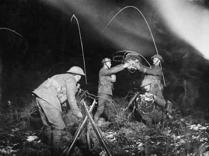 A wiring party at work at night in front of a support line with Very Lights in distance. Cambrai, 12 January 1917.