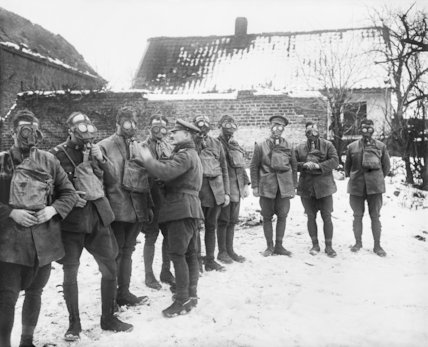 A Sergeant of the Northumberland Hussars inspecting the gas masks of his men. Etricourt, 1 January 1918.