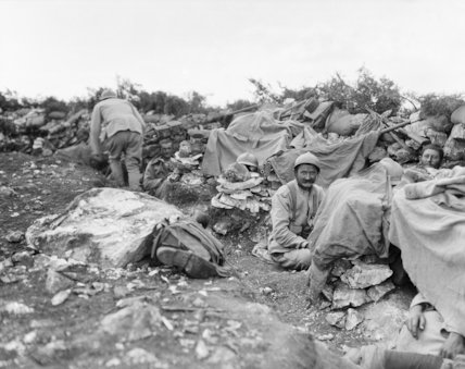 Serbian infantry manning shallow front line trenches in the mountains, September 1916.