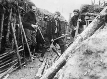 French soldiers chop timber for use in trench construction in the Aisne in 1915.