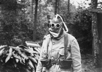 French Colonial soldier wearing gas mask. Somme area, 1916.