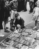 Children at comic stall Romford Market: c. 1947