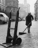 A road sweeper at work on Lower Thames Street: c. 1955