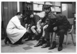 'Mods' try on Beatle boots at Annello and David,  1965