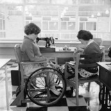 Disabled child sewing; 1957