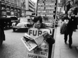Man wearing a sandwich board: 1961