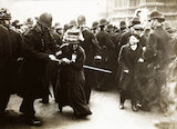 Suffragette struggling with a policeman on Black Friday; 1910