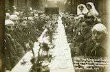 King George V and Queen Mary host a tea party for wounded soldiers & sailors at the Royal Mews; 1916