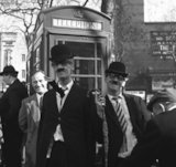 Two street entertainers dressed in suits, ties, bowler hats and glasses. c.1955