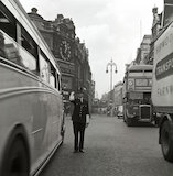A policeman directing traffic, New Oxford Street. c.1955
