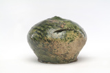 Green glazed ceramic money box: 14th century