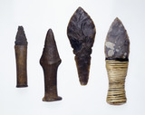 Three early bronze age daggers and a replica dagger