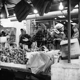 Four women at a market stall, Portobello Road: 1960