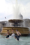 Boys playing in the fountains in Trafalgar Square; 2007