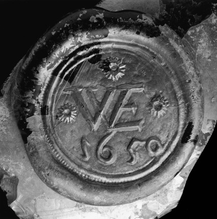 Wine bottle seal and body fragment: 1650