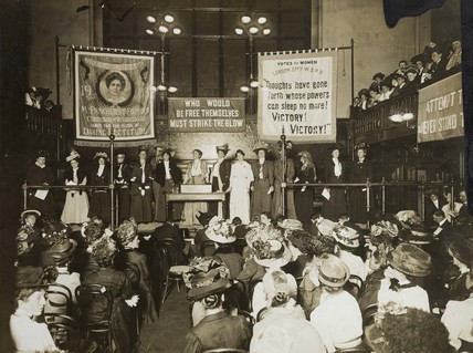 Mounted black and white photograph showing a Suffragette meeting: 1908