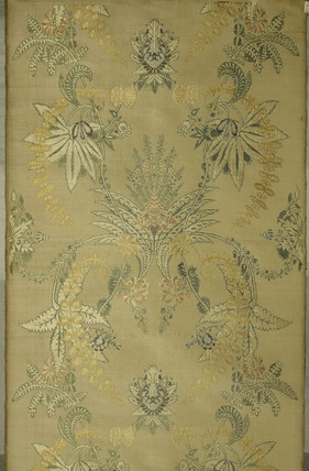 A detail of fabric from a brocaded silk dress; 1718-1722