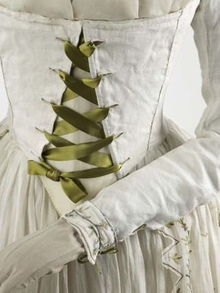 Dress and petticoat of fine white Indian muslin embellished with elaborate tambour embroidery: 1790