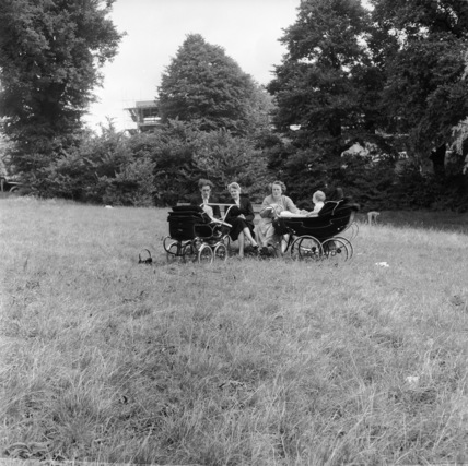 Parents in the park with their prams and babies, Hampstead Heath