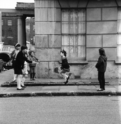 Children skipping in the street c 1956