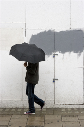 A man walking with umbrella in New Oxford Street; 2008