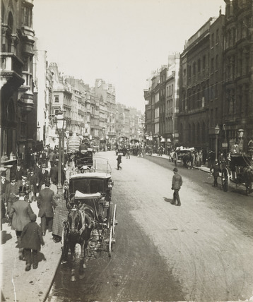 Busy street scene with horse-drawn cab in foreground; c1900