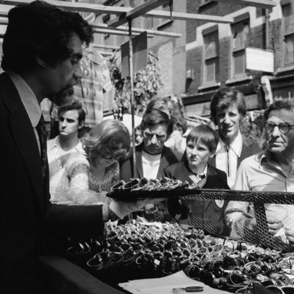 A salesmen displaying watches at Petticoat Lane market; c 1970