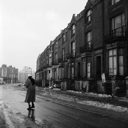 A woman photographed walking in the icy road on Bourne Terrace, Westminster; c 1963