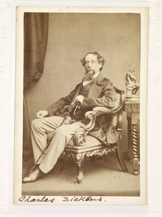 Charles Dickens seated; 1861