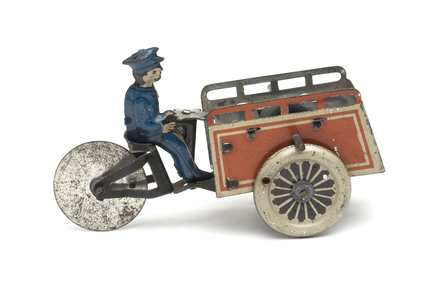 Tinplate mail delivery tricycle with postman cyclist; 1905-1910