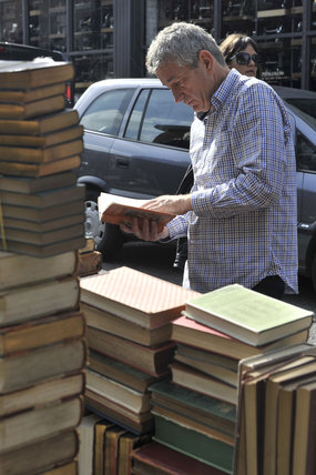 A man browsing on a book stall on Portabello Road; 2011
