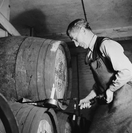 Customs Officials check casks of port at the London Docks; 1953