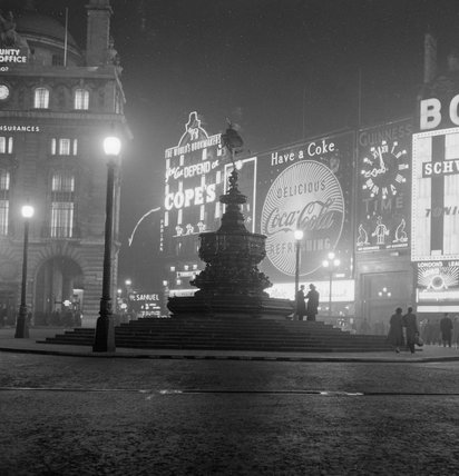 The statue of Eros in Piccadilly at night; 1958