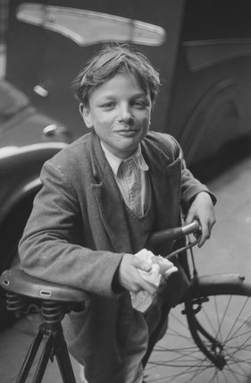 Boy in London's East End with a bicycle; 1954
