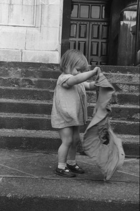 Girl with sack, East End of London; 1954