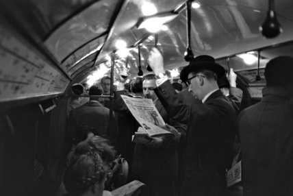 Commuters on a tube at rush hour; c.1960